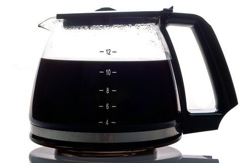 A partially filled glass coffee pot
