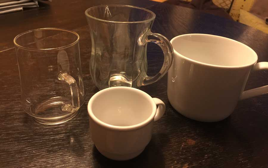 a selection of coffee cups and mugs