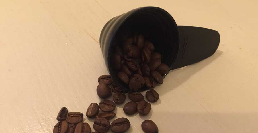 measuring scoop and coffee beans