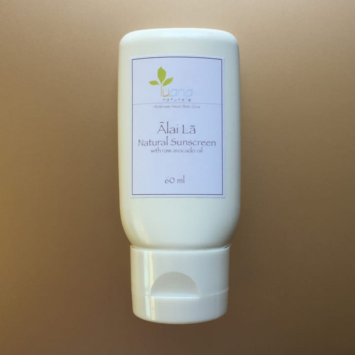 A tube of Ālai Lā Natural Sunscreen with raw avocado oil and 100% Kona coffee. Available at LuanaNaturals.com