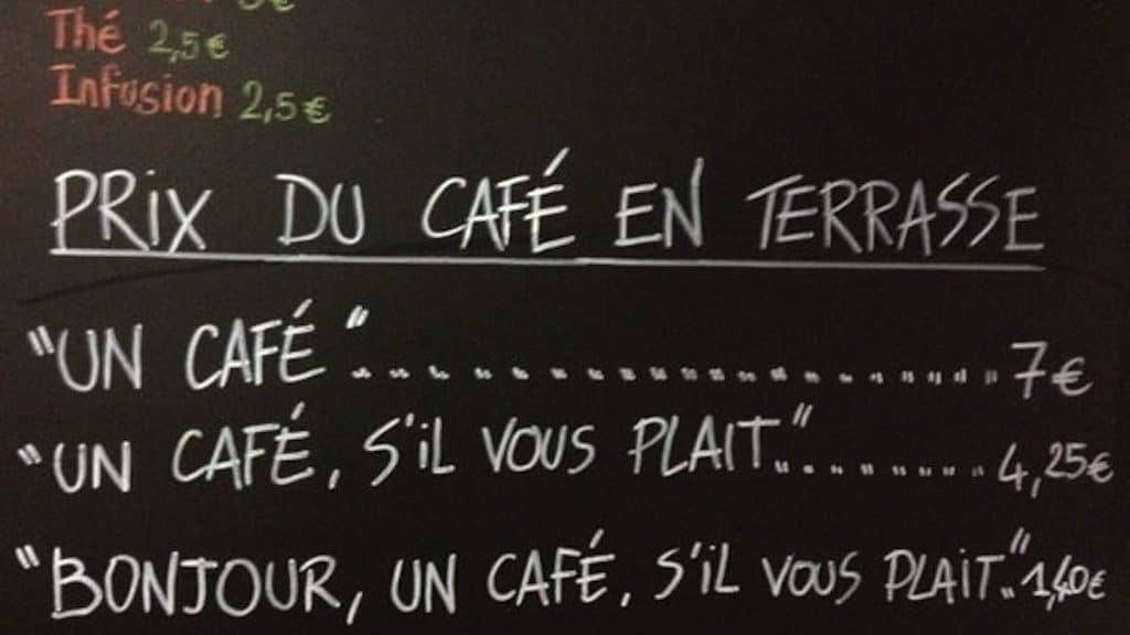 "Sign from a Nice, France cafe that says ""Un Cafe, 7 euro"", ""Un cafe, s'il vous plait, 4.25,"" and ""Bonjour, un cafe s'il vous plait 1.40"""