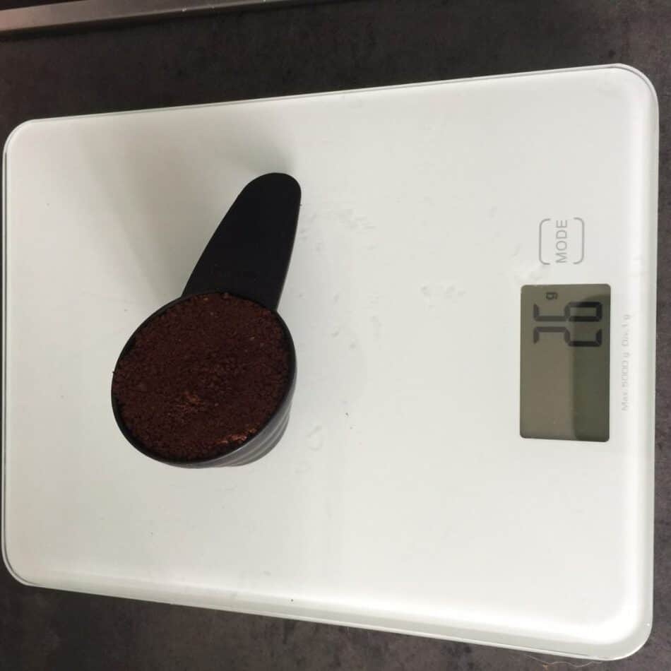 coffee in scoop being weighed