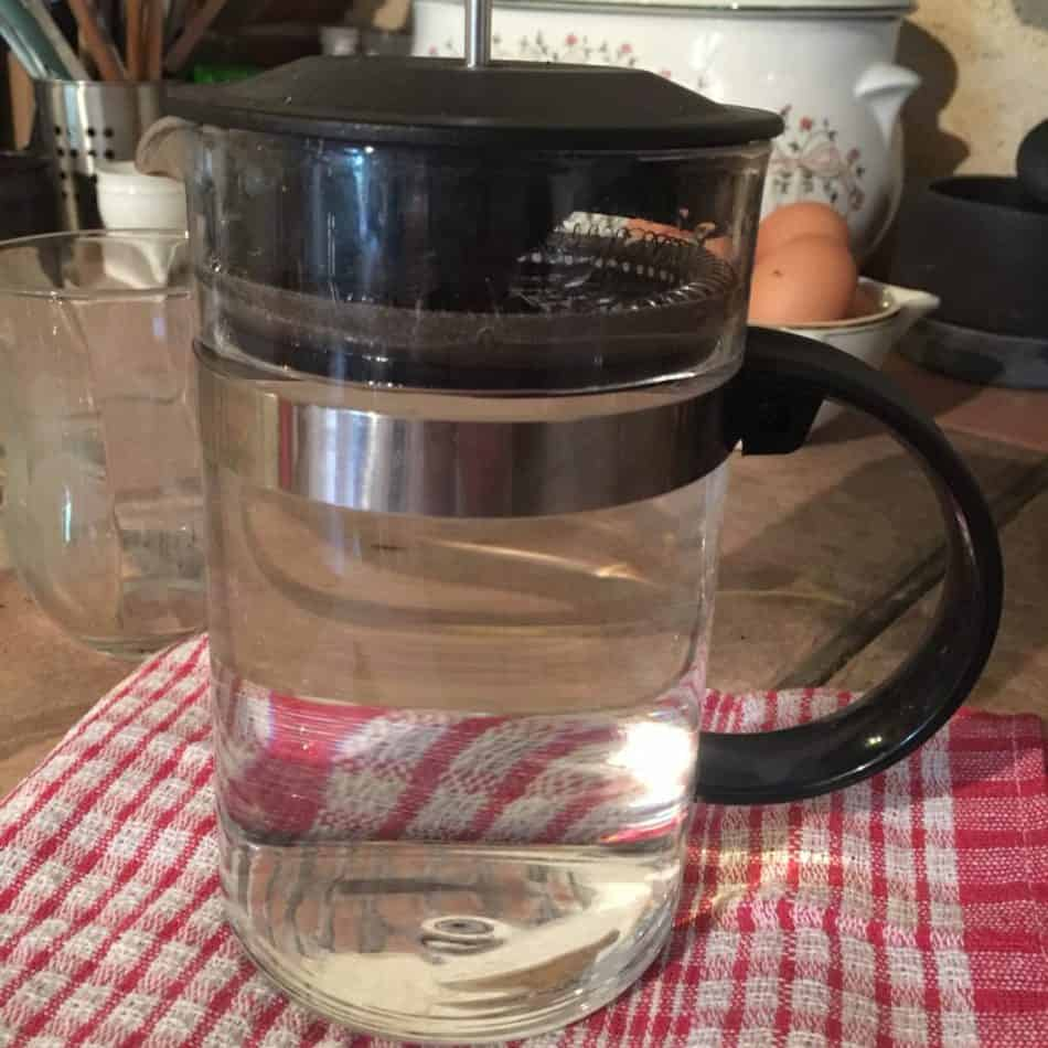French press pot filled with water