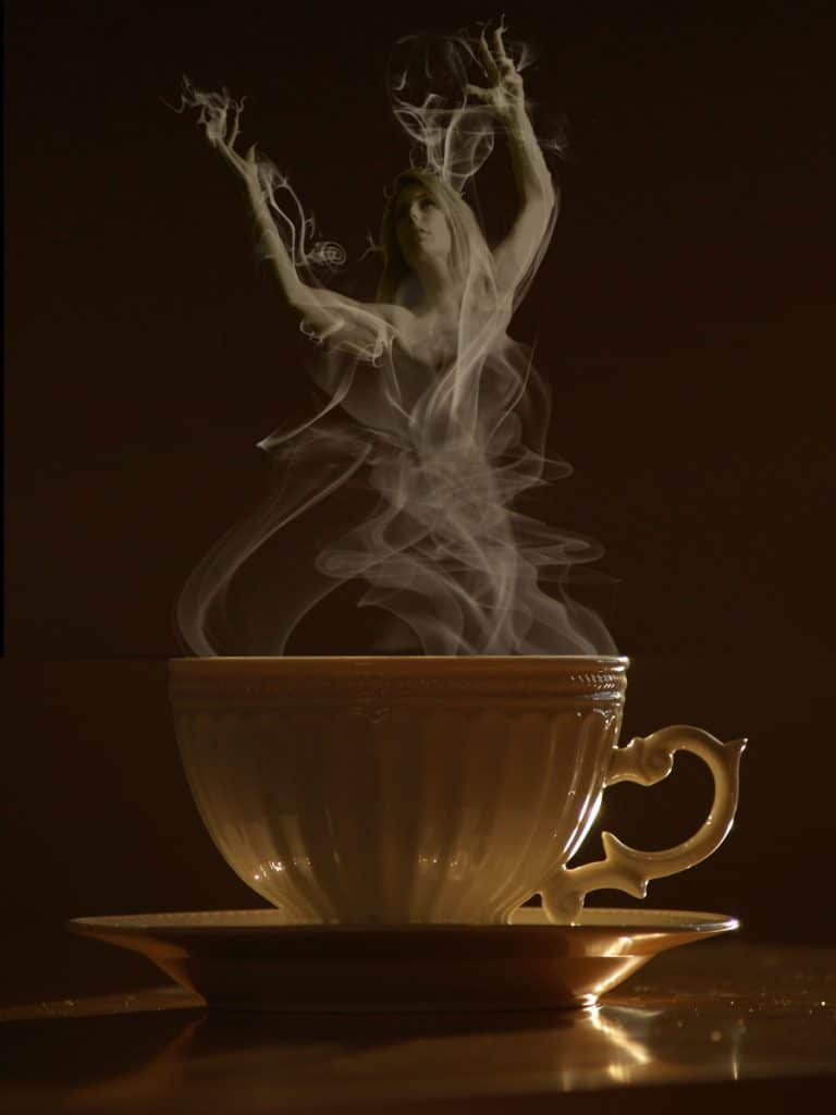 steaming cup of coffee forming the faux goddess Caffeina